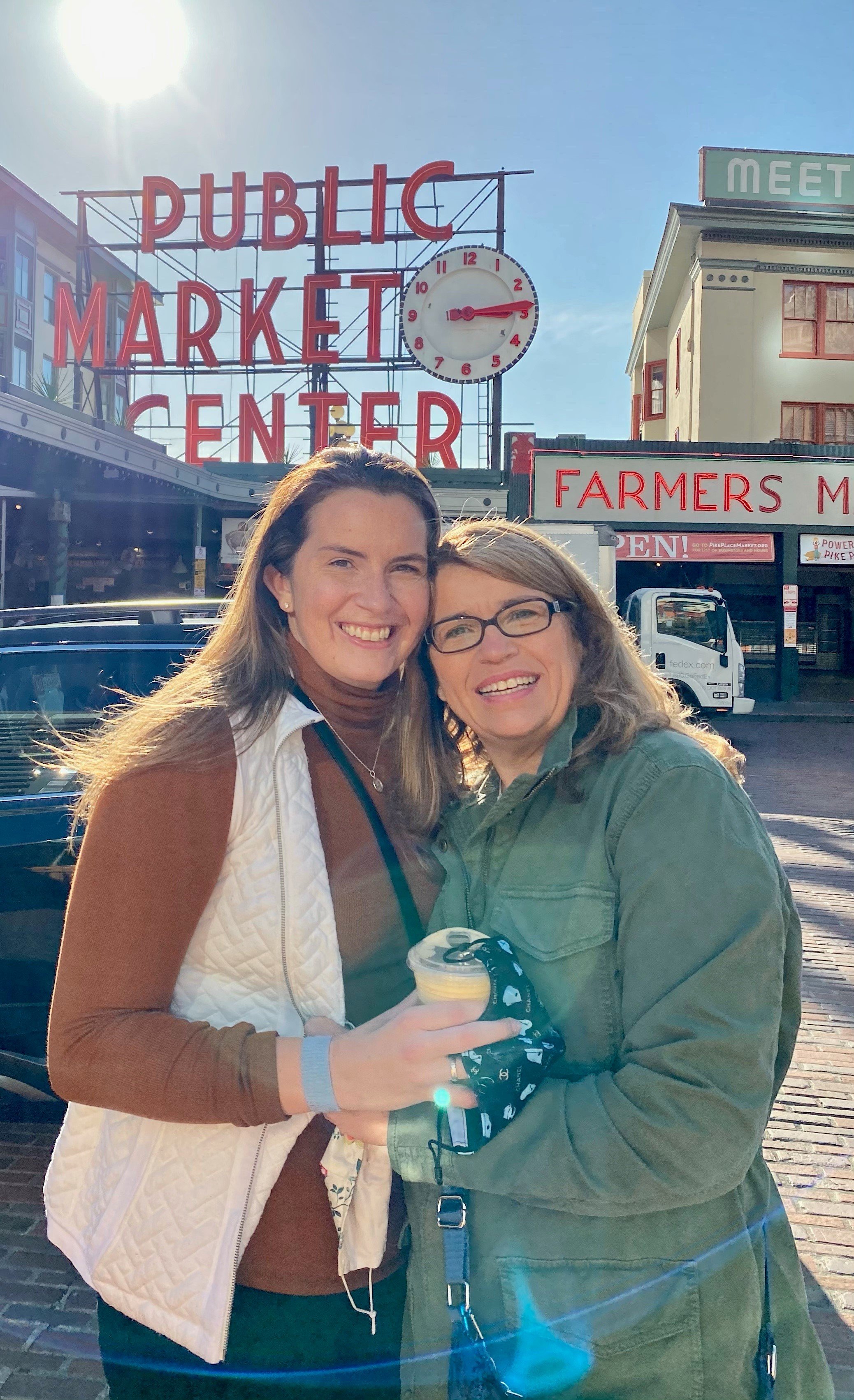Rhiannon with her mom in front of Pike Place Market