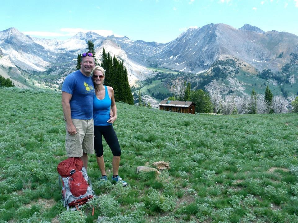 Susan with her partner on a hike in the mountains