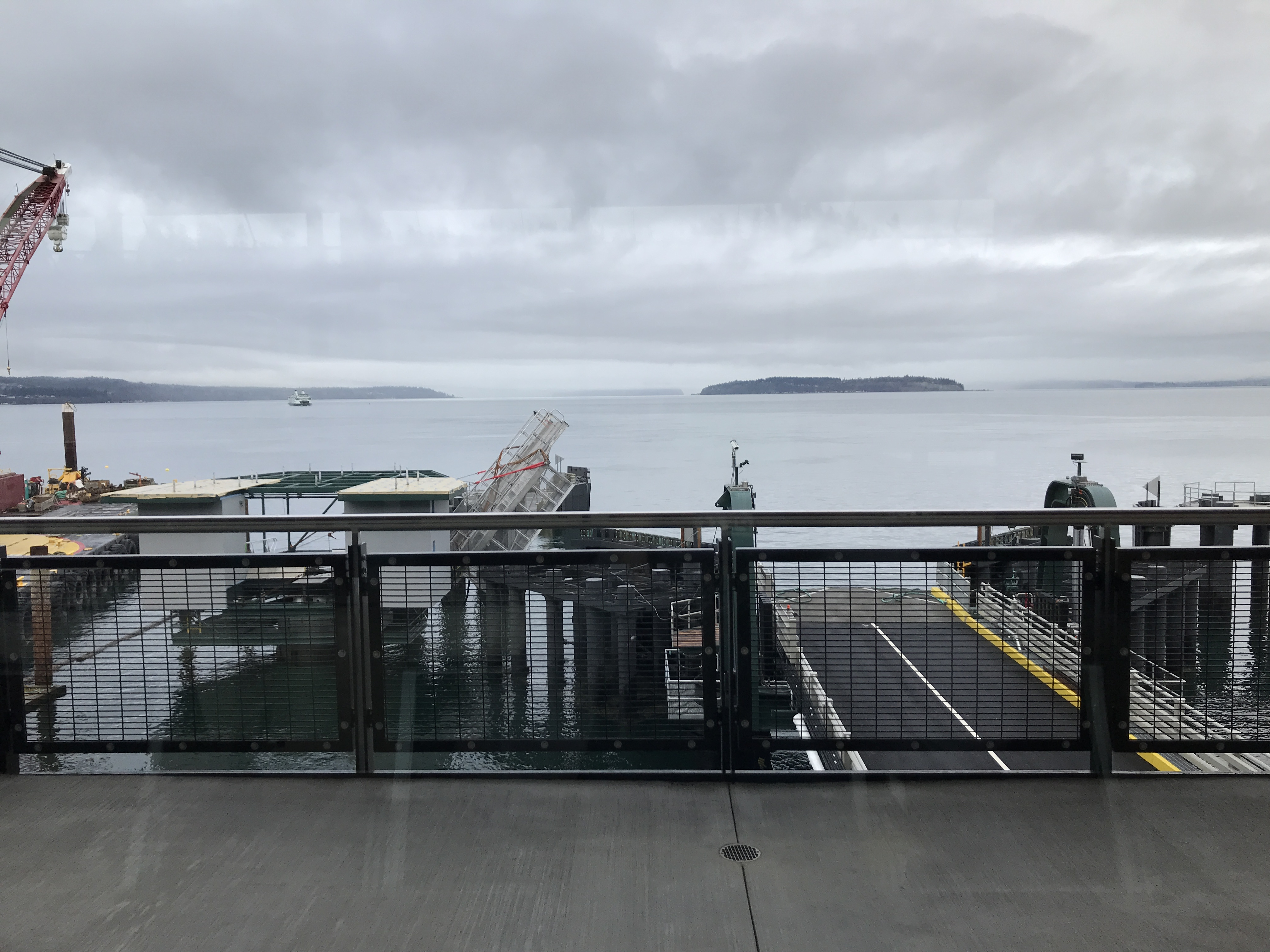 a gray, cloud sky overlooking the Puget Sound from the ferry